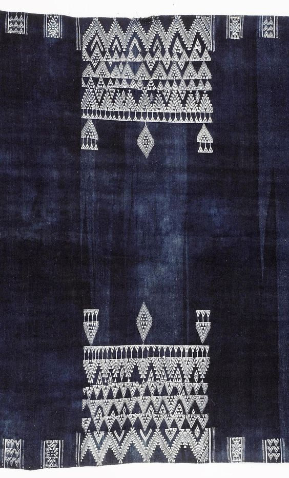 Africa   Detail from a shawl, Bakhnuq, from Tunisia   Wool & cotton; the indigo field with two central rectangular panels of white zig-zag and pendant motifs, with geometric borders, tassel fringes to either end