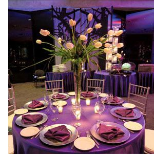 Tall vase is a great way to have a large centerpiece and people can still see everyone at the table!