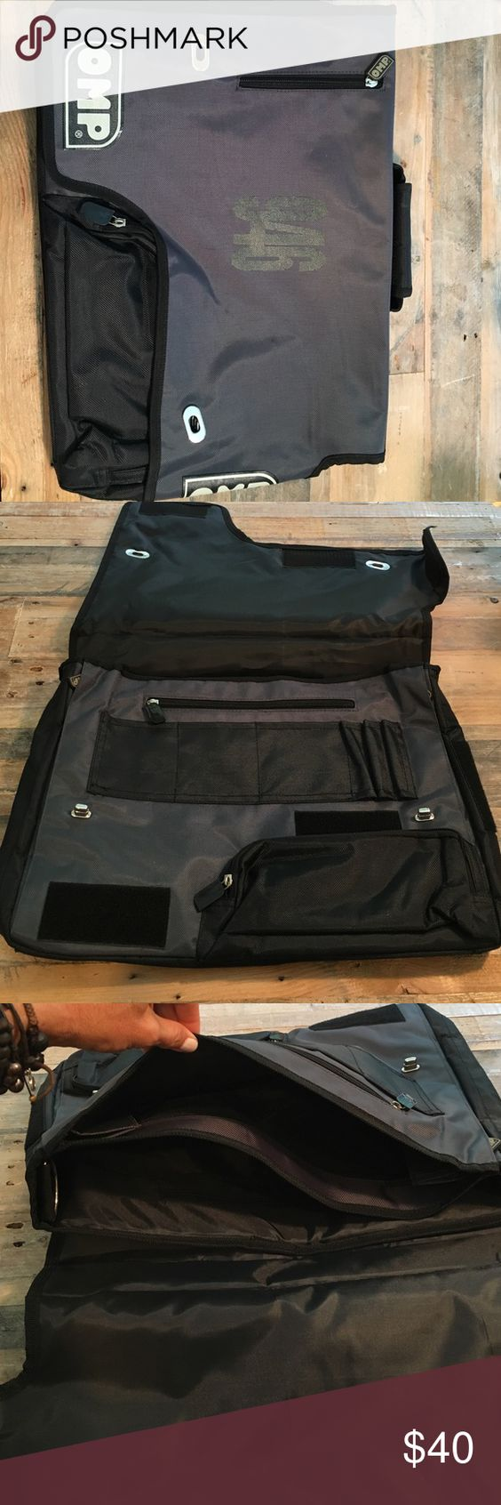 Large OMP messenger bag NWOT Brand new... Grey/black messenger bag/portfolio...many zipper pockets...Velcro pockets inside & out... Handheld & crossbody strap included. Super Drive style never used! OMP Bags Crossbody Bags