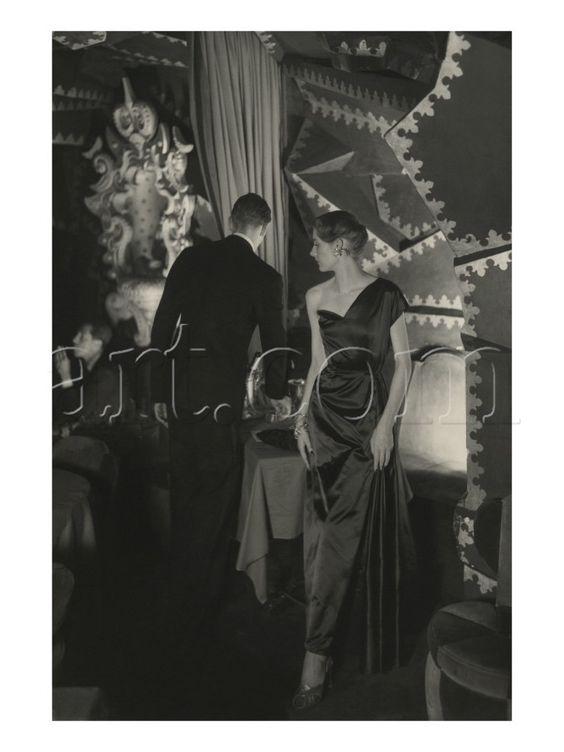Elsa Schiaparelli The model wears an asymmetrical, one-shouldered evening dress photo Donald Honeyman's in the famed Parisian nightclub Schéhérazade. October 15, 1949, Vogue