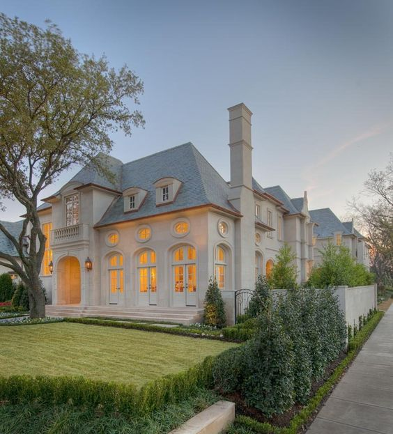 French chateau style home in stucco cast stone for French chateau exterior design
