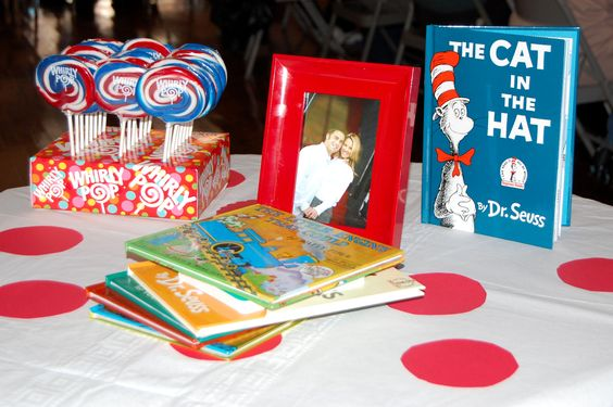 Dr. Seuss decor at baby shower. Mom-to-be keeps all the books for baby!