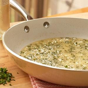 This delicate white wine sauce from Cooking Light uses dry white vine, chicken broth and a splash of white wine vinegar.
