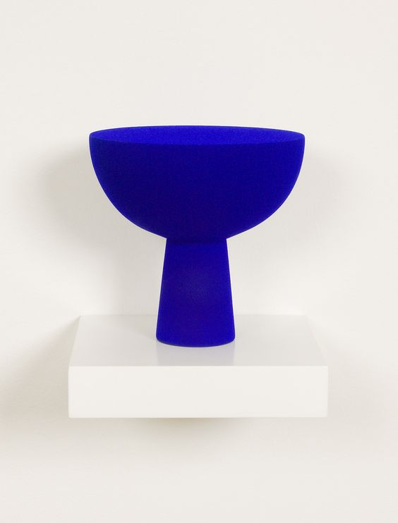 blue vessel. Yves Klein (1928-1962) is perhaps best remembered as a painter of blue monochrome paintings. More specifically, he is known for the particular shade of blue paint employed in his paintings and sculptures, the trademarked International Klein Blue (IKB).: