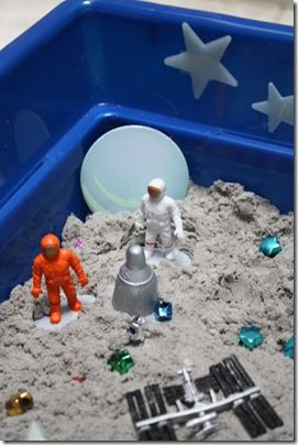 moon sand and glow in the dark stars for space sensory tub. Might need to get some of those space toys!: