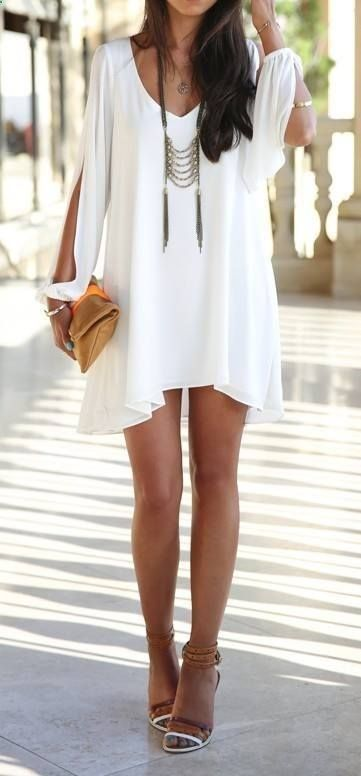 Brown Clutch. Flowing White Dress. Shopping. Long Necklace. Strappy Sandals. #SoleilGlow #GotItFree