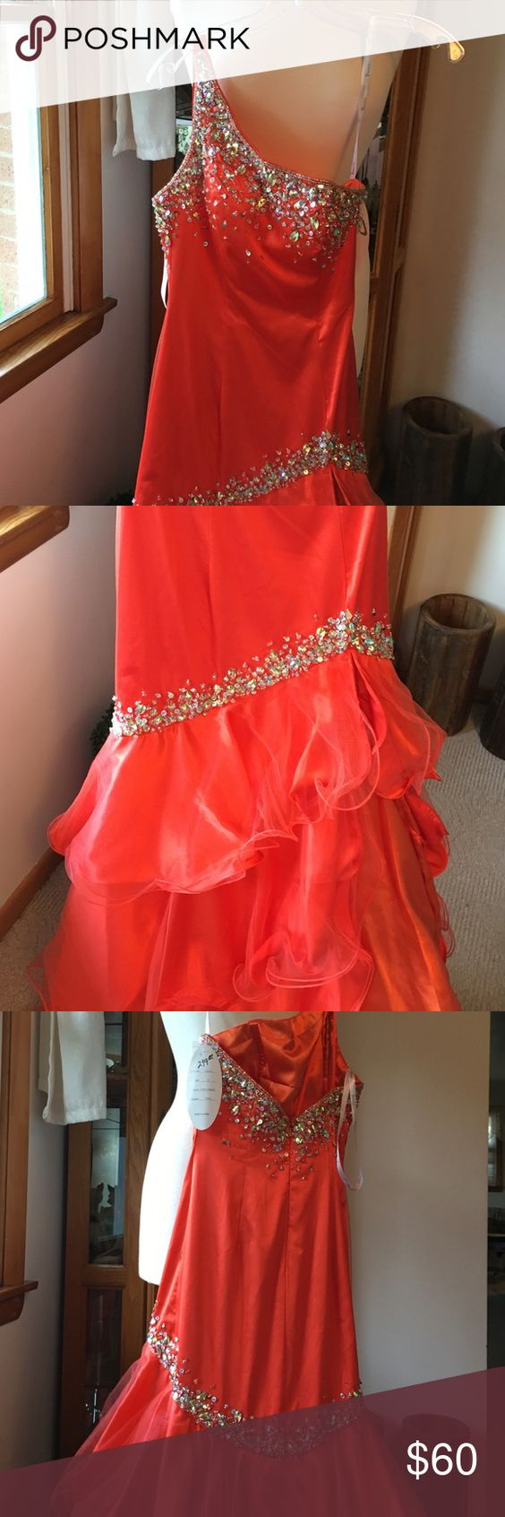 Gown Striking orange gown with silver sequins around the top and below the waist. Ruffles and slit at the bottom. One shoulder. Panoply Dresses Prom