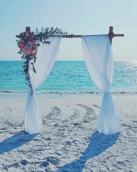 Bamboo Wedding Arch: Ritz at Lido Beach Sarasota Florida . By Scarlett's Flowers
