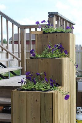 Raised bed flower planters along deck stairs. MANITOBA GARDENS: Featured Garden - Our Hoops Loop Garden