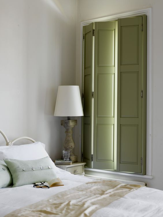 Add some traditional elegant to a bedroom design with - Solid panel interior window shutters ...