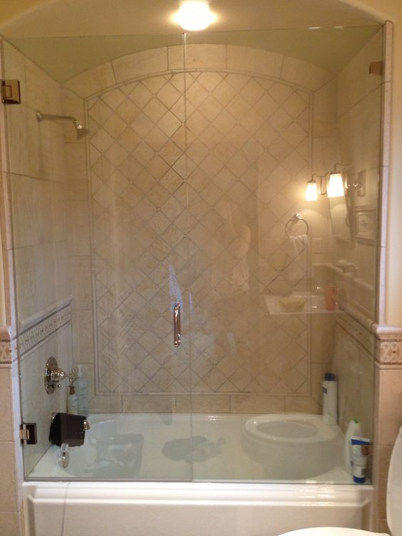 Glass enclosed tub shower combo bathroom design pinterest tub shower combo tile design Bathroom remodel with walk in tub