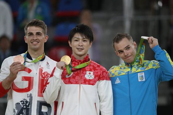 Bronze medalist Max Whitlock of Great Britain, left, gold medalist Kohei…