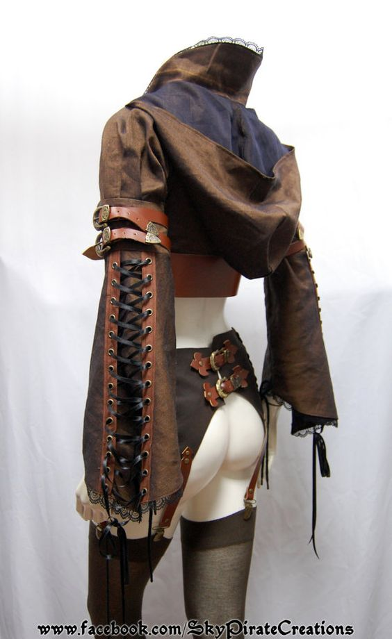 ***READY TO SHIP***  This listing is for a one of a kind hooded bolero jacket. The belts are made from real leather and features flowery