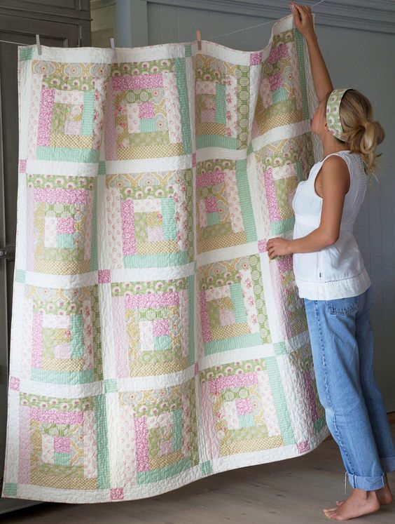This sweet Apple Bloom Quilt is 58 x 58 Inches (170 x 170 cm) and great for picnics, as a play quilt or a cozy sofa quilt. If you want a bed quilt you can easily add another Log Cabin row or two. Each row will including the border build 16,5 inches (41 cm).