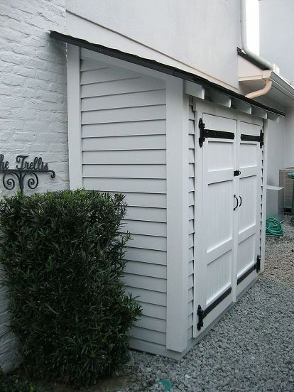 small storage for along the side of a house, outdoor living, shelving ideas, storage ideas, A small but attractive shed set along the side of a house With some shelves it can store quite a bit all with easy access Can also be placed next to a fence