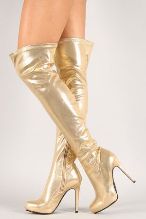 """Metallic Almond Toe Stiletto Thigh High Boot. Description These eye-catching  thigh high boots  feature a shimmery metallic vegan leather throughout, almond toe silhouette, and wrapped stiletto heel. Finished with lightly cushioned insole, and partial side zipper closure for easy on/off.Material: Metallic Vegan Leather (man-made)Sole: Synthetic  Measurement Heel Height: 4.5"""" (approx)Shaft Length: 24"""" (including heel)Top Opening Circumference: 14"""" (approx)Fitting Tips:Foot Model is a true…"""