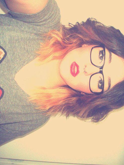 Short / medium length, dark ombre hair to light. Orange, bleached?