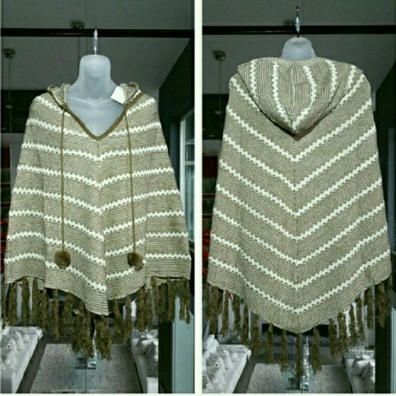 SALEBCBG poncho This gorgeous hooded fringed poncho with pom pom ties from BCBG, will make a fabulous addition to any wardrobe. Perfect for cooler fall and winter weather. Colors are cream and tan with gold threading weaved throughout to give this Poncho alittle sparkle.   96% acrylic 2% metallic 2% nylon  size s/m  New with tags attached BCBG Sweaters Shrugs & Ponchos
