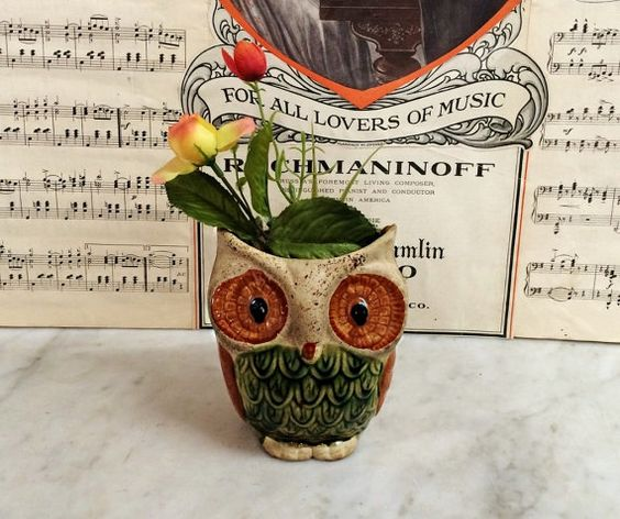 Where can you buy a VINTAGE 1960S POTTERY HORNED OWL VASE? Here and hes awful cute. Hes a tan bisque with glazed green feathers and orange-brown eyes and wings. I love the wonderful colors and it swung me back to the SIXTIES. I had an orange chair and avocado green shag rug! This mod fellow would be perfect for holding spoons or napkins. https://www.etsy.com/listing/464514904 $24.00.