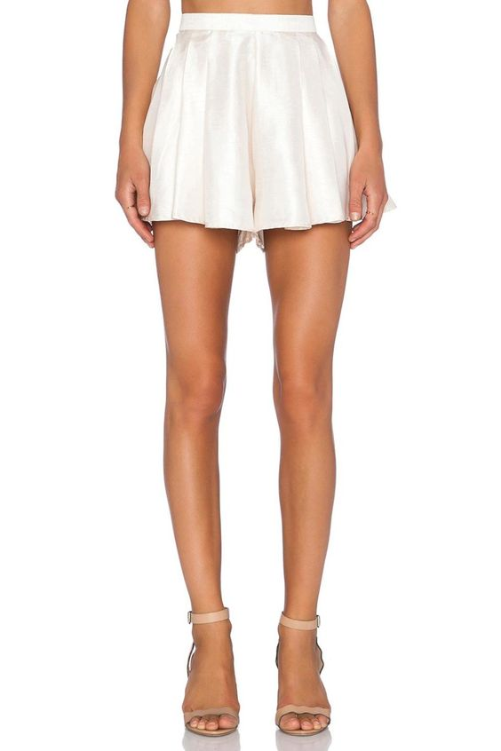 The Help Me Shorts are a high-waisted short that open from the back with a exposed metal zipper. The shorts have an all over pleated form with a raised seam at the sides.   Help Me Shorts by C/MEO COLLECTIVE. Clothing - Shorts - High-Waisted Louisiana