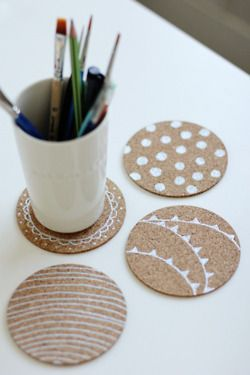 cork coasters painted with white motif