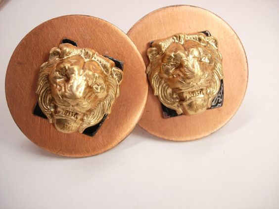 These are a dramatic large pair of Lion Heads mounted on large copper discs. The Lions heads are in the Victorian Style and mounted on slaps of