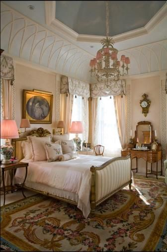 What a fabulous bedroom! Look at that ceiling! That alone would make the room, but the Aubusson rug, the lovely window treatments, & the total French elegance all come together so well. More formal & traditional than most people do now, but it's timeless- will never really go out of style.