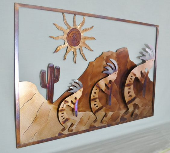 "Notice how the sun seems suspended from the sky. The colorful layers create a sense of depth as the Kokopellis play their flutes through the cactus-lined desert. Click through the pictures to see how different angles of light create myriad color variations in the metal. This is truly a one of a kind piece of Southwestern wall décor. Wall Mount Hardware Included. (Please see the final photo.) Dimensions:H: 20""W: 31""D: 0.5""Weight: 8 lbs."