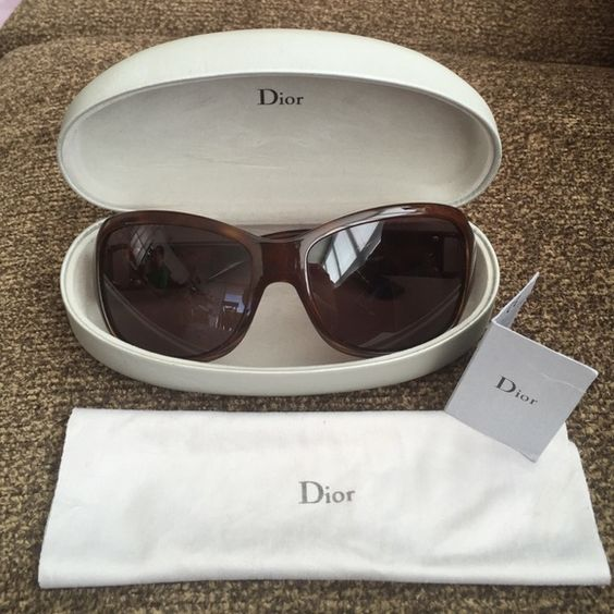 Christian Dior Sunglasses Dior Brown Sunglasses - 100% authentic. Originally purchased from Bloomingdales. These are several years old so show signs of wear. There are light scratches on the lenses, otherwise no cracks or fading on the hardware.  Offers welcome! Check out my closet for other listings Dior Accessories Sunglasses