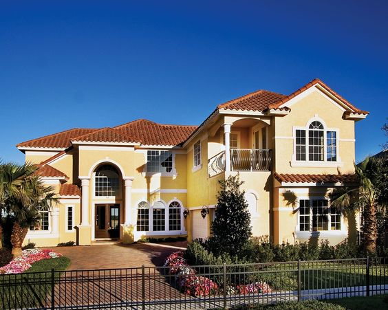 yellow stucco house with red tile roof in orlando random
