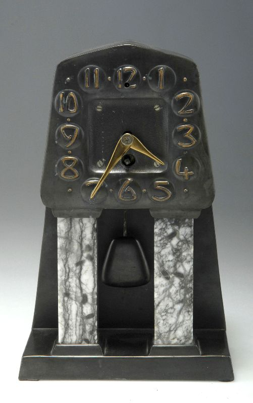 Albin Müller. Table clock, 1906. H. 31 cm; 19.2 x 11.2 cm. Made by Fürstlich Stolbergsches Hüttenamt, Ilsenburg. Cast iron, black patina, brass, white-grey Alabaster.