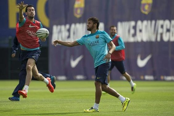 Barcelona's Lionel Messi plays with a rugby ball during a training session at Ciutat Esportiva Joan Gamper training camp, near Barcelona