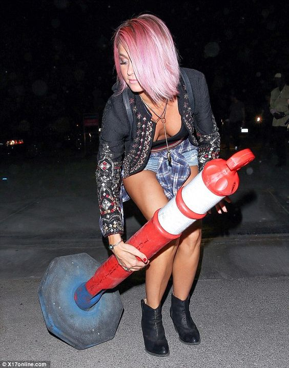I got this: the dancer helped the stricken bollard back to its feet...