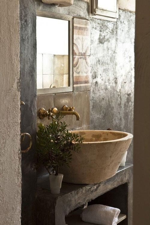 love the faucets in the wall and the sink on top of the wooden shelf