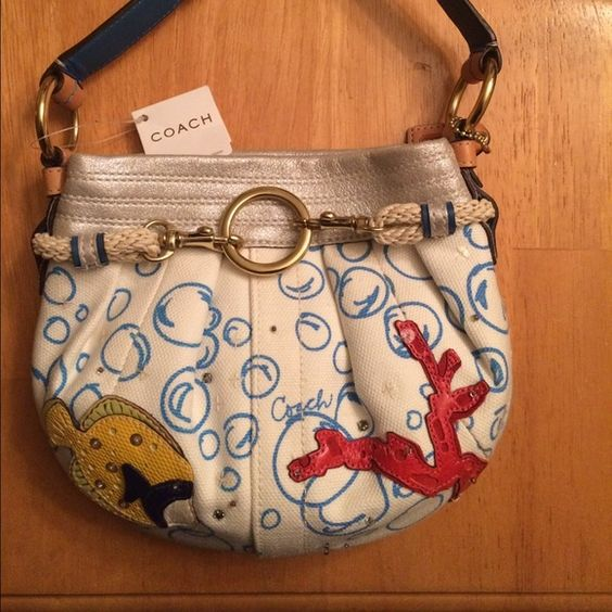 Coach Bubble Ocean Fish limited Edition Rare Coach #H05Q-4455 White canvas with ocean blue bubbles Front features yellow fish a red coral reef Braided rope detail Coach tag/charm dangling from strap Tan strap Gold hardware Snap button opens purse to blue silk interior Zipper pocket Coach Bags Hobos