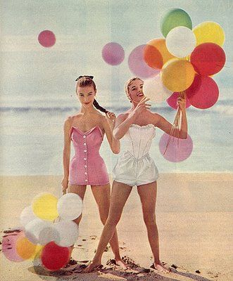 vintage girls on beach in swimsuit with balloons