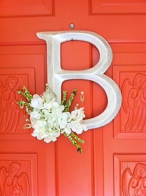 Love this idea -- hang a single letter on the front door instead of a wreath.