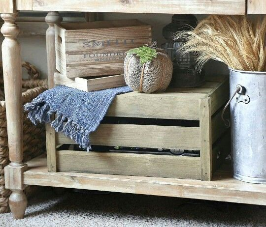 Under an open console used as a tv stand, hide the cable box in a crate with gaps large enough so the remote still works