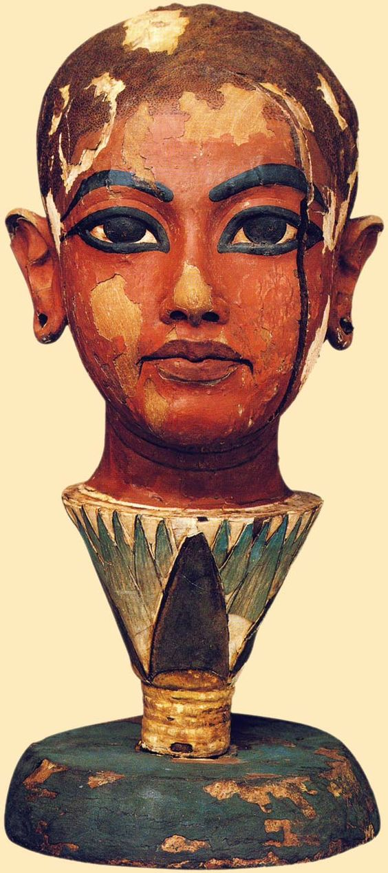 """Painted wooden head of Nefertem or Tutankhamon (1334-1325 a.C.) depending on source.(""""Nefertem is possibly """"beautiful one who closes"""" or """"one who does not close"""" was originally a lotus flower at the creation of the world, who had arisen from the primal waters. Nefertem represented both the first sunlight and the delightful smell of the blue lotus flower, having arisen from the primal waters within an blue water-lily"""" --wikipedia)"""