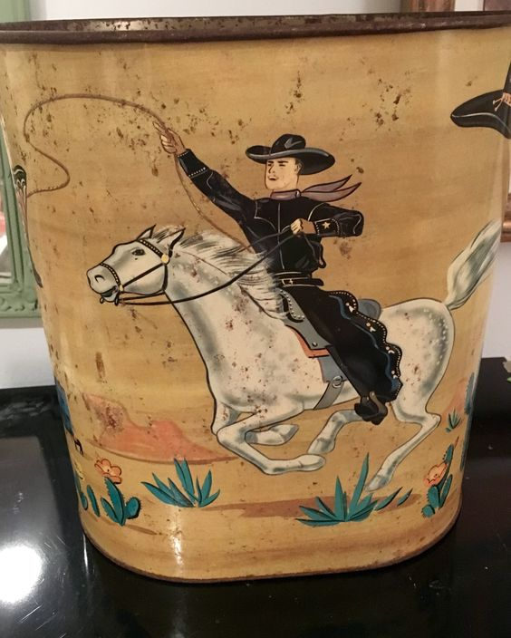 Vintage wastebasket cowboy on one side cow girl on the other side