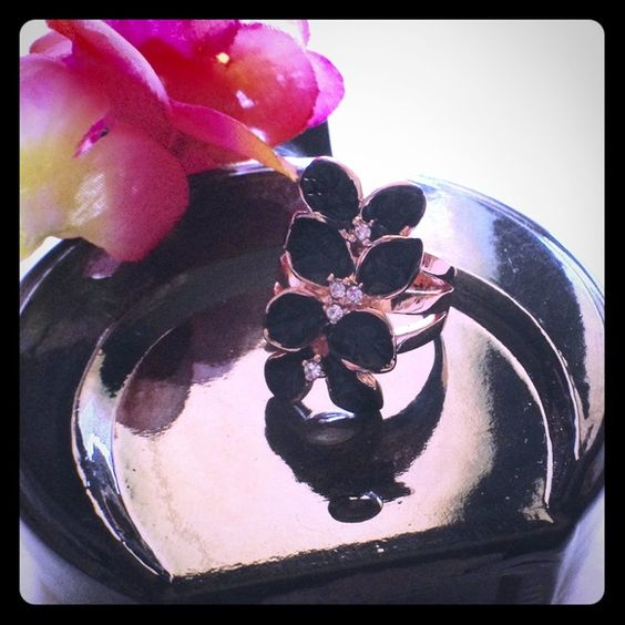 Black Flower Rose Gold Ring Rose gold filled ring with a beautiful black flower. Size 7 Brand new in package MC's Boutique Jewelry Rings