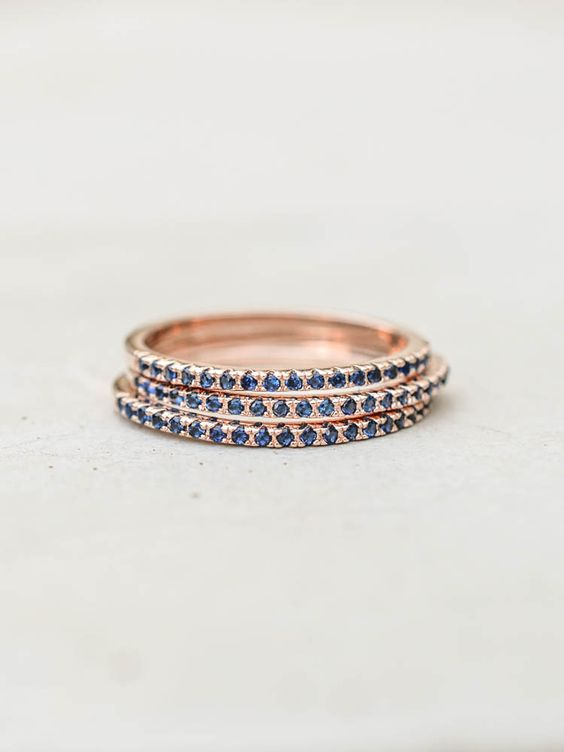 This eternity band ring set consists of three rose gold plated brass rings and…