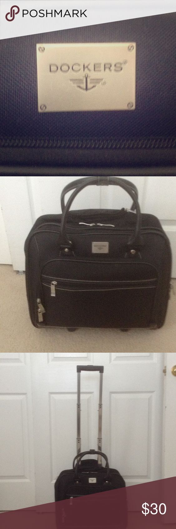 Carry on Dockers Luggage used only once. Selling because I have another one like this. Four compartments with dividers inside. Fits under the airplane seat. Dockers Other