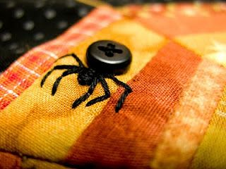 Spider buttons on a adorable spider web mini quilt!  This would be fun for Halloween.