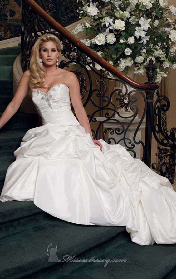 Draped Skirt Dress by David Tutera   Item #211251 by David Tutera (Fall, 2012)        $1,258.00  Make a lasting impression with this floor length taffeta bridal gown By David Tutera 211251. The ruched bodice features a sweetheart neckline, with beaded embellishment, and a drop waist accented with delicate crystal and beaded embellishments. Stunning draping forms the A-line skirt with chapel train to finish this breathtaking ensemble. Detachable spaghetti and halter straps are included.
