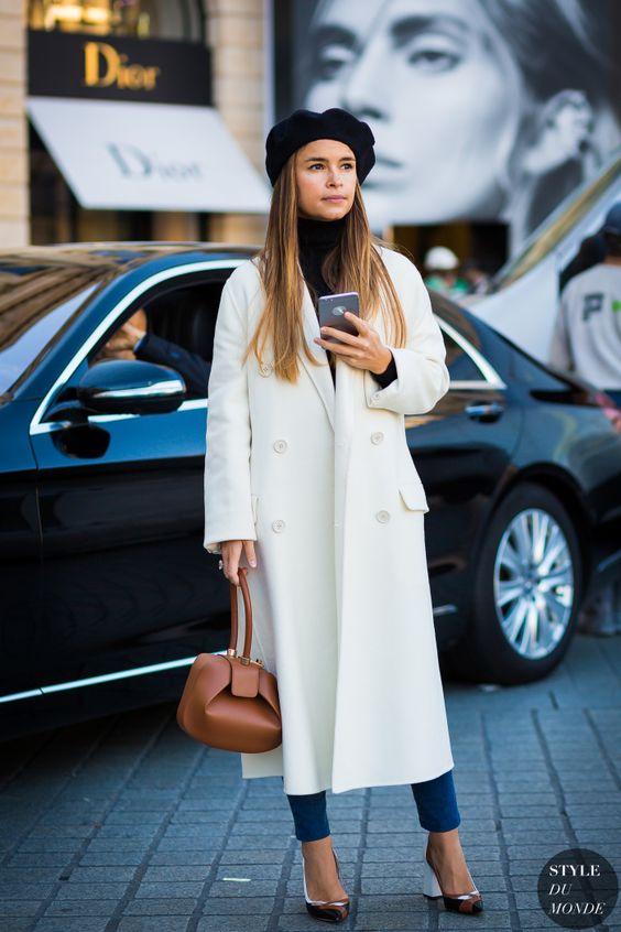 Mira Duma wears a beret & a white maxi coat