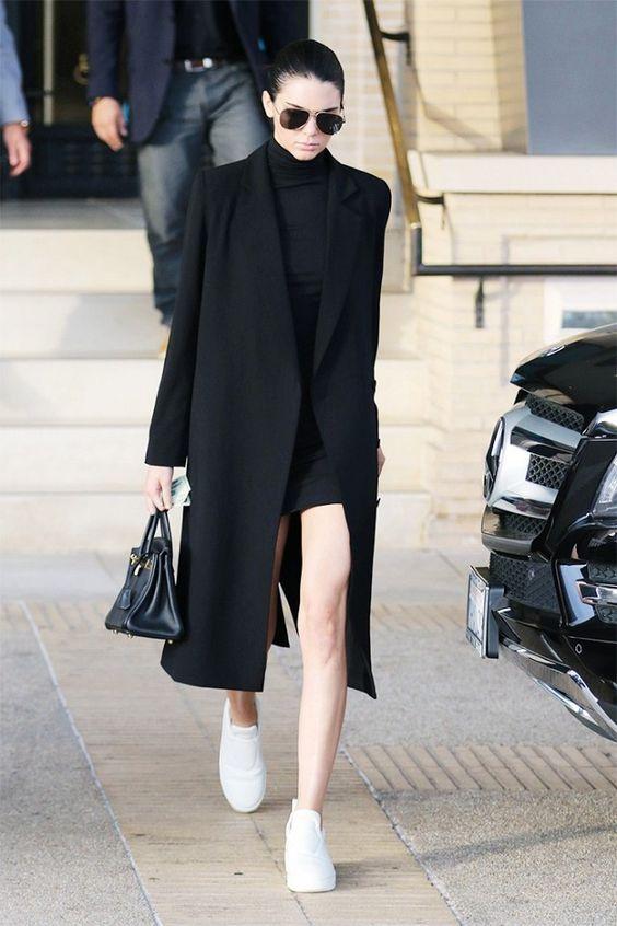 Kendall Jenner looks sleek in a black mini dress, long coat, white sneakers, and a Birkin bag