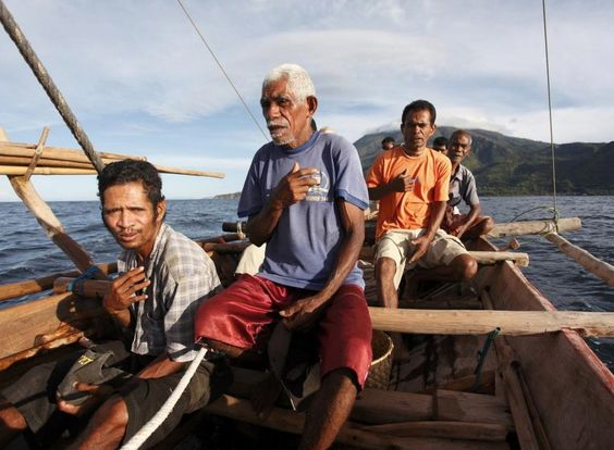 During a traditional whale hunt in a wooden boat called 'pradang' men pray ...