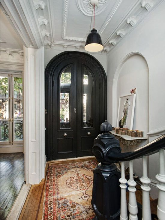 This is a wonderful front door and entryway!  Love the floors, the old Oriental and the black and white.  Love, love, love!