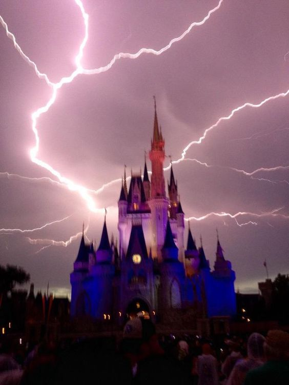 Lightning strikes over Cinderella Castle at Disney World As a lightning storm rolled through Central Florida Magic Kingdom attendees captured what looks like a near miss to Cinderella Castle by a bolt. www.orlandosentin...
